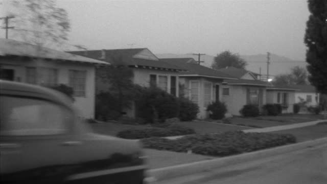 1955 pov car driving through suburbs / san fernando valley, california - 1950 stock videos & royalty-free footage