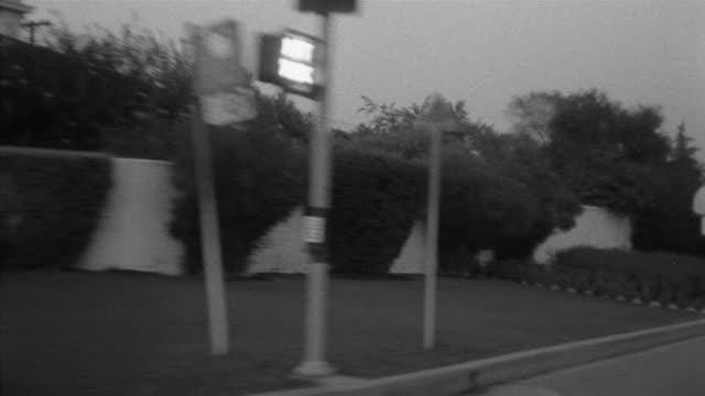 1955 POV Car driving through suburbs / Toluca Lake, Southern California