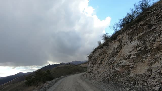 car driving through the northern road which runs from the northern karabakh town of martakert in nagorno-karabakh to vartenis in eastern armenia on... - dirt track stock videos & royalty-free footage