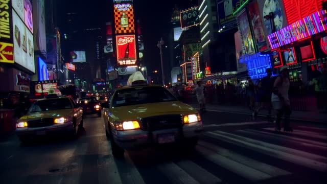 vídeos y material grabado en eventos de stock de rear pov car driving through times square at night, new york city, usa - 2001