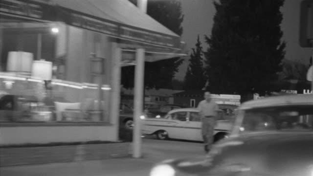 1955 pov car driving through toluca lake district at night / toluca lake, southern california - toluca lake stock videos & royalty-free footage