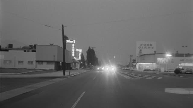 1955 pov car driving through toluca lake district in evening / toluca lake, southern california - toluca lake stock videos & royalty-free footage