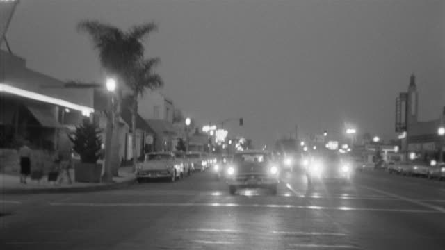 1955 pov car driving through toluca lake district in evening / toluca lake, southern california - anno 1955 video stock e b–roll