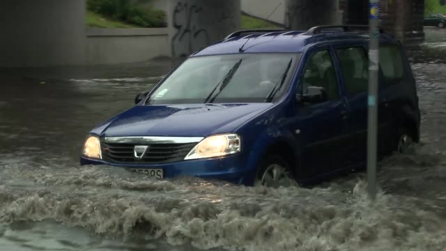 car driving under flooded viaduct - flood stock videos & royalty-free footage