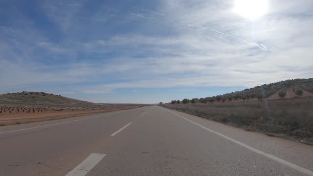 car drivng in a country road in spain - driving plate stock videos & royalty-free footage