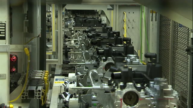 Car engines on an assembly line at the Ford car plant in Bridgend
