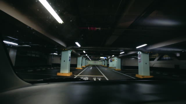 car entering parking garage, - car park stock videos & royalty-free footage