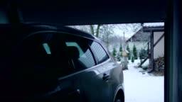Car entering the garage. Winter landscape