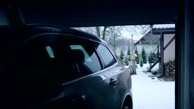 car entering the garage. winter landscape - fanale anteriore video stock e b–roll