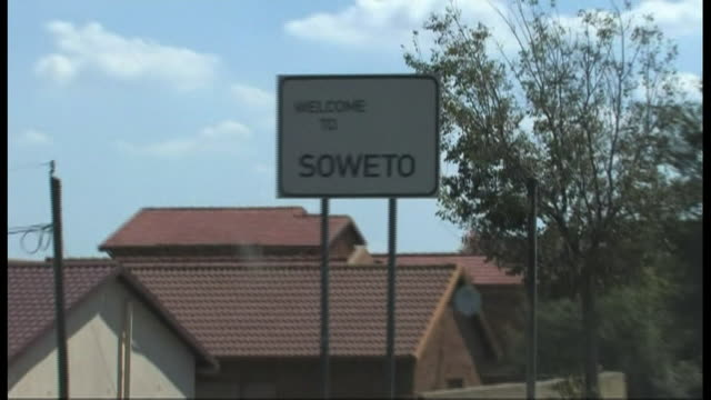 a car enters soweto in johannesburg. - soweto stock videos and b-roll footage