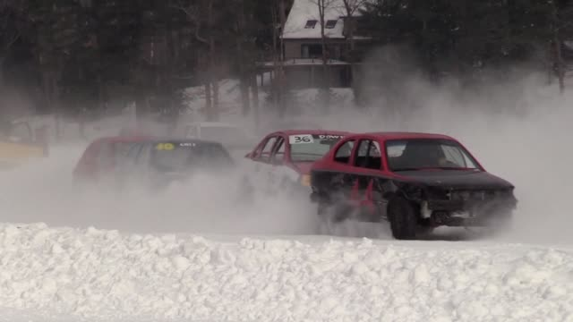car enthusiasts take part in the 35th latchkey cup which sees drivers race on a frozen lake in new hampshire in the northeast united states - privatfahrzeug stock-videos und b-roll-filmmaterial