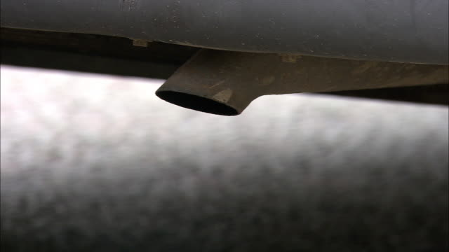 Car exhaust pipe vents fumes, Bristol, UK