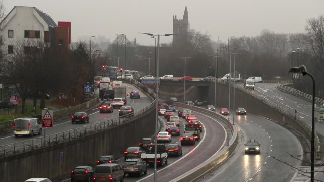 car exhausts can be seen as vehicles drive in rush hour traffic on january 9 2018 in bristol england the uk government recently announced that it is... - on air englisches schild stock-videos und b-roll-filmmaterial