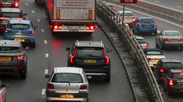 Car exhausts can be seen as vehicles drive in rush hour traffic on January 9 2018 in Bristol England The UK government recently announced that it is...