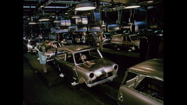 montage car factory manufacturing the b.m.c. mini in longbridge / united kingdom - longbridge stock videos & royalty-free footage