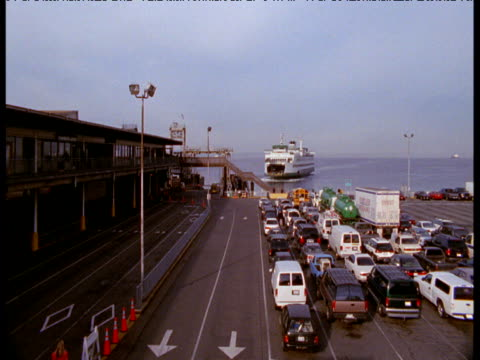 Car ferry arrives and vehicles unload, Seattle