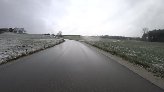 Car POV: first snowfall on the road