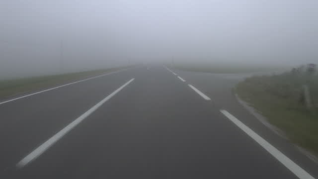 car pov: foggy austrian country road in autumn - austria stock videos & royalty-free footage
