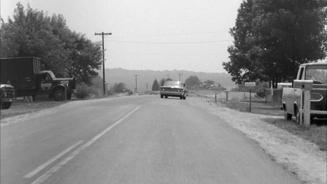 ws pov car following at street of countryside - limousine familienfahrzeug stock-videos und b-roll-filmmaterial
