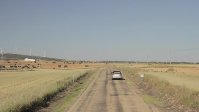 Car going away far in a desert road