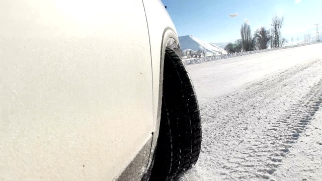 slo mo car having bad traction in the snow - super slow motion stock videos & royalty-free footage