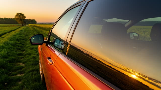 t/l car in the countryside at sunrise - stationary stock videos & royalty-free footage