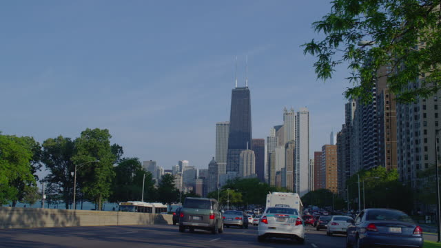 WIDE car POV in traffic on Lake Shore Drive toward downtown Chicago