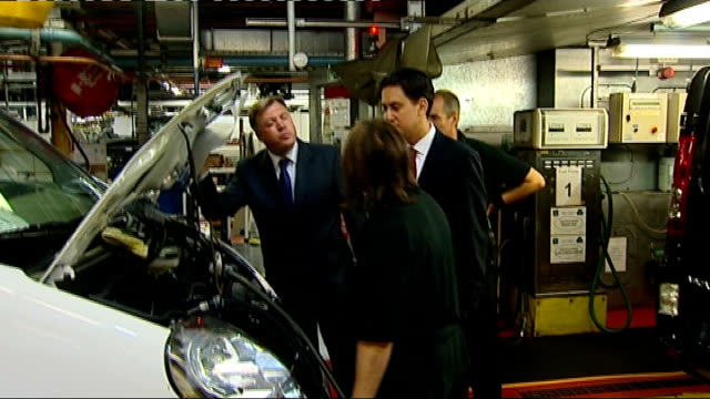 ed miliband and ed balls visit vauxhall motors in luton; more shots ed miliband and ed balls on tour of car plant, being shown van engine / balls and... - tour of britain stock videos & royalty-free footage