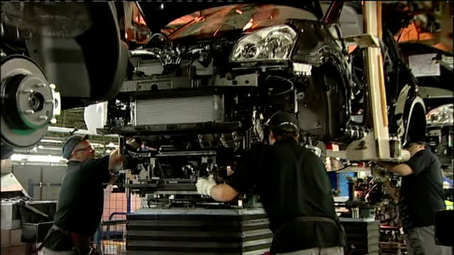 honda shuts down swindon factory for four months date location unknown factory workers assembling cars on production line car being driven off... - ホンダ点の映像素材/bロール