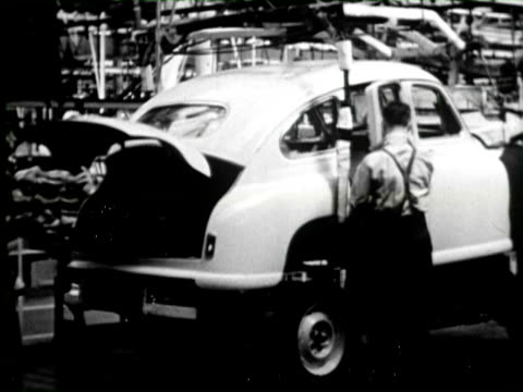 b/w car industry people polishing steal, england / audio - 自動車産業点の映像素材/bロール