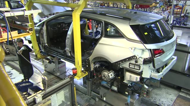 peugeot agrees deal with general motors to buy vauxhall; r03031615 / england: cheshire: ellesmere port: int various of cars on production line - general motors stock videos & royalty-free footage