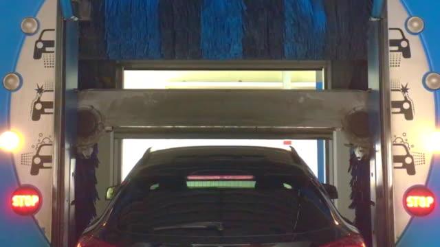 car inside a car wash machine in locarno, ticino, switzerland. - biltvätt bildbanksvideor och videomaterial från bakom kulisserna