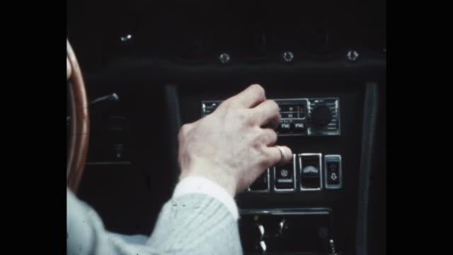 vidéos et rushes de car interior, hand of man operating dashboard, usa, 1970's - image animée
