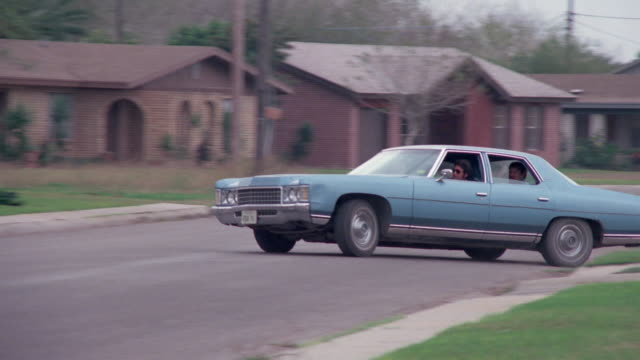 car is chasing another car. blue and white car. dramatization. - 1970 1979 stock videos & royalty-free footage