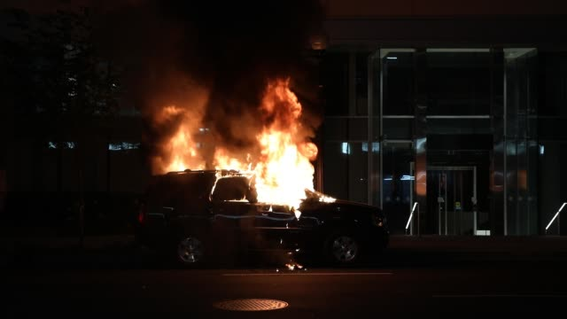 a car is on fire during a protest near lafayette square park on may 30 2020 in washington dc across the country protests were set off by the recent... - george floyd stock videos & royalty-free footage