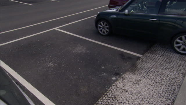 a car is parked in a parking lot. - parking stock videos & royalty-free footage