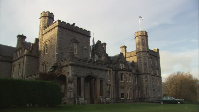 a car is parked outside a magnificent scottish castle. - castle stock videos & royalty-free footage
