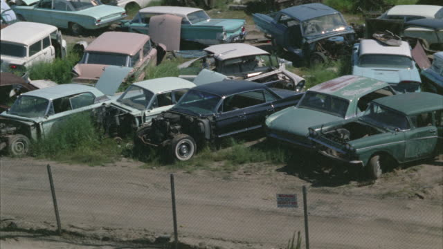stockvideo's en b-roll-footage met 1963 montage car junkyard / sun valley, california - 1963