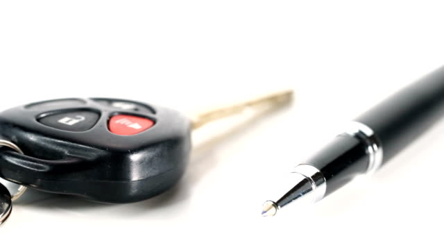 car key and pen loan concept - lease agreement stock videos & royalty-free footage