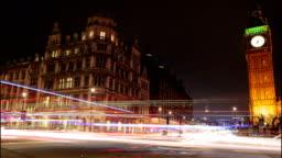 Car light trails slow motion night timelapse showing Westminster and Big Ben in London, England, UK