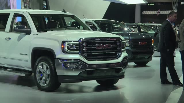 car makers appeal to americans' deep love of suvs and trucks at the detroit auto show unveiling a host of choices from luxurious to utilitarian while... - sedan stock videos & royalty-free footage