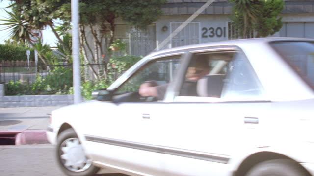 a car makes an erratic stop on santa monica's ocean park avenue. - ocean avenue stock videos & royalty-free footage