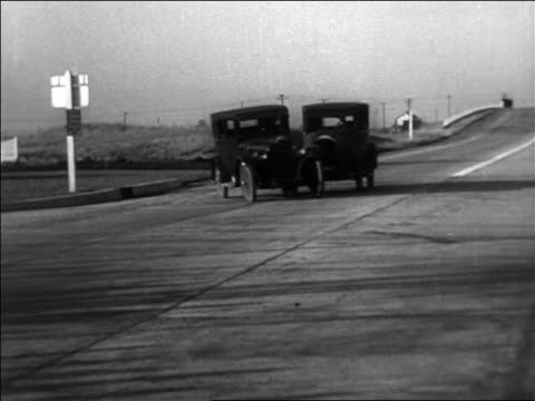 b/w 1934 pan car making left turn + colliding with 2nd car in left lane / staged car collisions - 1934 stock videos & royalty-free footage