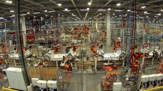car manufacture, timelapse - attrezzatura industriale video stock e b–roll