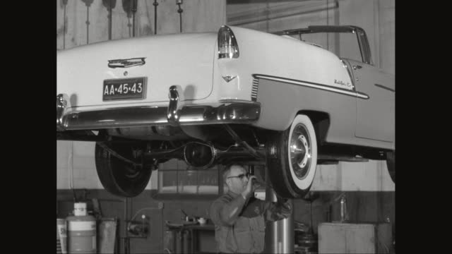 ms car mechanic at work in repair garage / united states - tire vehicle part stock videos and b-roll footage