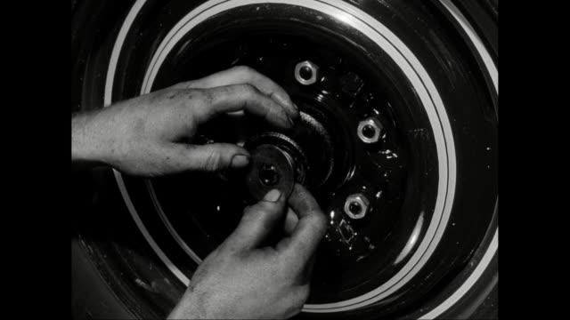 cu car mechanic fitting car wheel / united states - repairing stock videos & royalty-free footage