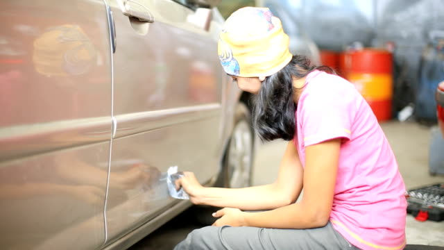 car mechanic in garage - body paint stock videos & royalty-free footage