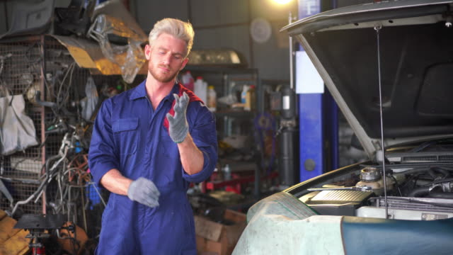 car mechanic with wrench working at auto repair shop - wrench stock videos & royalty-free footage
