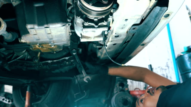 car mechanic working at auto repair shop - mechanic stock videos & royalty-free footage