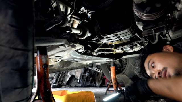 car mechanic working at auto repair shop - quality control stock videos & royalty-free footage